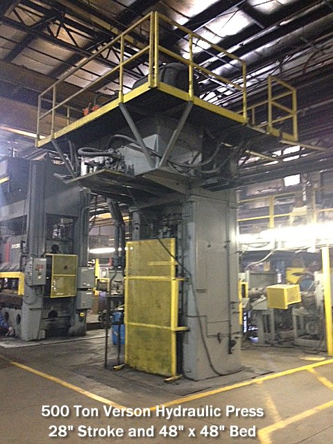 "500 ton verson hydraulic press which has a die bed area of 48"" by 48"" and a 28"" stroke..."